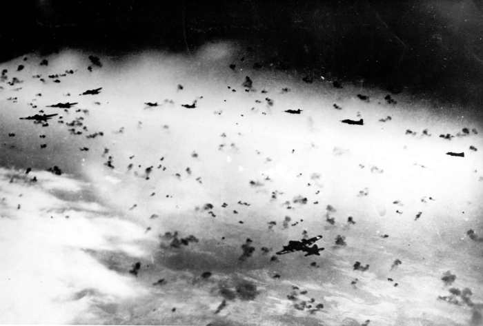 "B-17s in ""Flak so thick you could almost taxi around on it."""